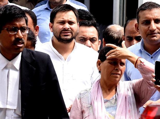 Rabri Devi and Tejashwi Yadav at Patiala House Court in New Delhi on Friday