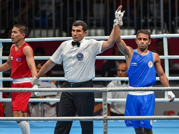 Amit beats Rio champ to win India its only boxing gold