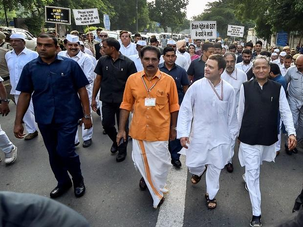 Congress President Rahul Gandhi with senior leader Ghulam Nabi Azad and others during 'Bharat Bandh' protest march against fuel price hike and depreciation of the rupee, at Rajghat in New Delhi, Monday, Sept 10, 2018 (Photo: PTI)