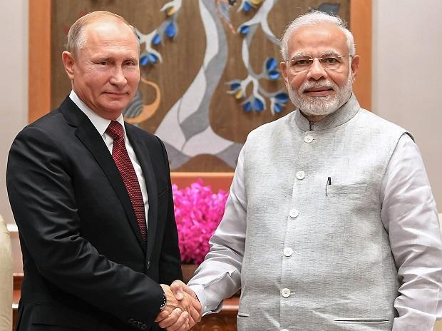 New Delhi: Prime Minister Narendra Modi greets Russian President Vladimir Putin before their meeting in New Delhi. Photo: PTI