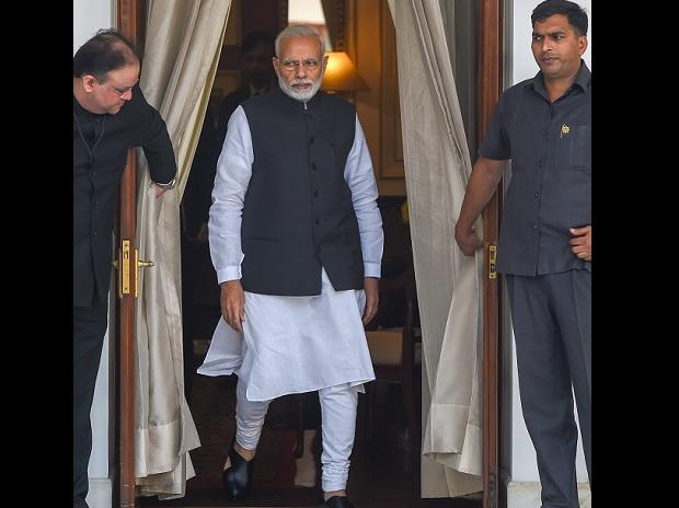 Prime Minister Narendra Modi arrives for a meeting with his Sri Lankan counterpart Ranil Wickremesinghe at Hyderabad House, in New Delhi, Saturday