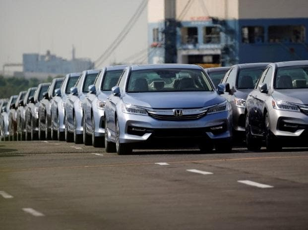 Newly manufactured cars of the automobile maker Honda await export in a port in Yokohama  Photo: Reuters