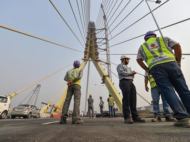 New Delhi: Engineers inspect the infrastructure of the iconic Signature Bridge over the Yamuna River ahead of its inauguration on Friday, November 2, 2018. Photo: PTI