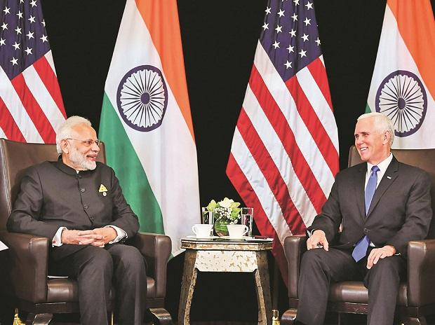PM Narendra Modi (left) and US Vice-President Michael Pence in Singapore on Wednesday (Photo: PTI)