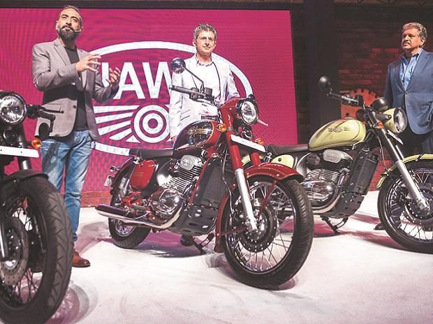 (From left) Classic Legends and Phi Capital Management founder Anupam Thareja, Rustomjee group CMD Boman Irani and Mahindra group Chairperson Anand Mahindra at the launch of Jawa bike models Jawa, Jawa 42, and Jawa Perak, in Mumbai, on Thursday (Phot