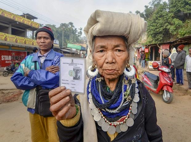 A Bru tribal woman shows her identity card as she waits to cast her vote at a polling station for the state Assembly elections, at Kanhmun, Mizoram. Photo: PTI
