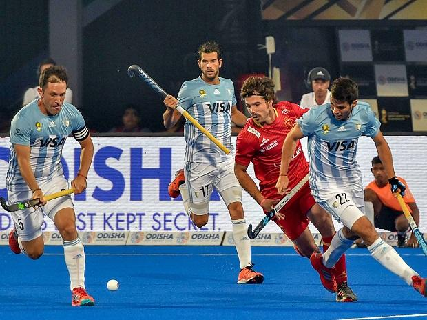 rgentina's players (blue and white) in action during a match against Spain at the Men's Hockey World Cup 2018, in Bhubaneswar, Thursday. PTI Photo