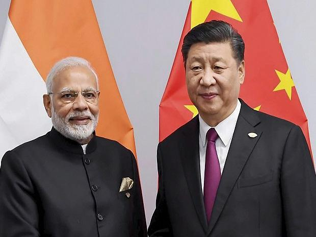 Prime Minister Narendra Modi shakes hands with Chinese President Xi Jinping on the sidelines of G-20 summit, in Buenos Aires, Friday. (PIB Photo via PTI)
