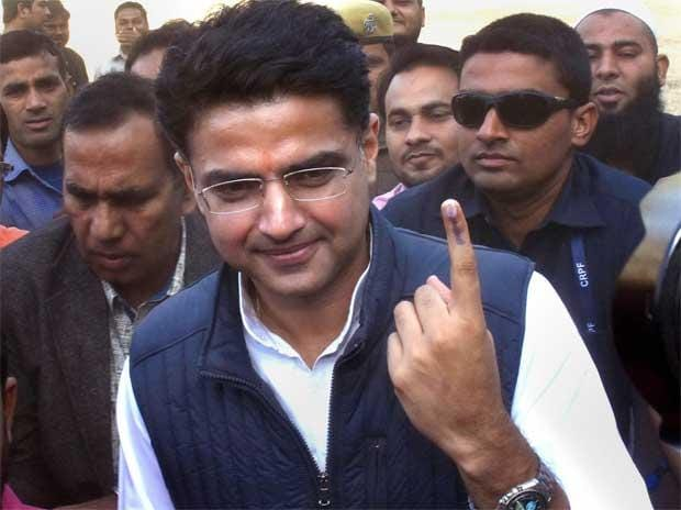 Rajasthan Congress chief Sachin Pilot shows his ink-marked finger after casting vote for the state Assembly elections, in Jaipur