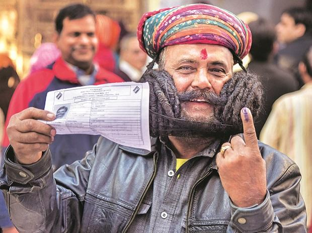 Girdhar Vyas, who claims to sport the longest moustache in the world, after casting his vote in Bikaner. Photo : PTI