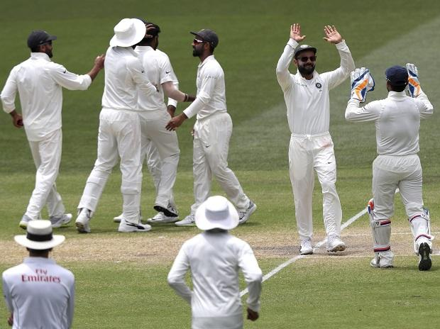 Indian players celebrate the dismissal of Australia's Tim Paine on the final day of the first cricket test between Australia and India in Adelaide. AP/PTI