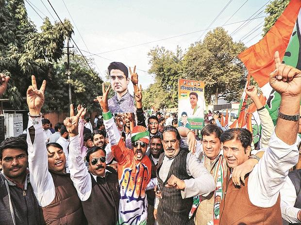 Congress workers and supporters celebrate  at the party office in Jaipur on Tuesday photo:PTI