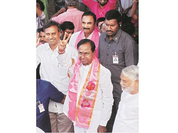 TRS chief K Chandrasekhara Rao shows the  victory sign at the party headquarters after the results gave a landslide victory to his party in the Assembly polls photo:PTI