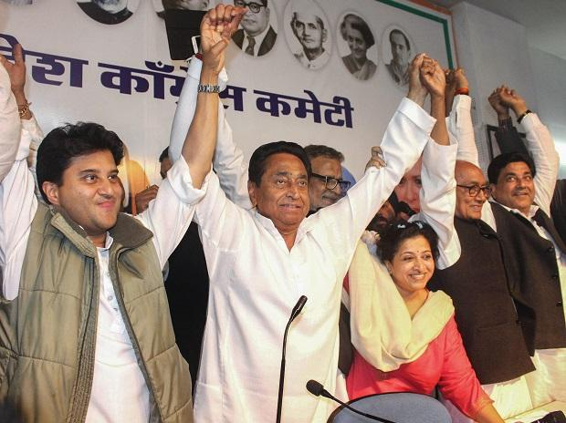 Congress State President Kamal Nath, party leaders Jyotiraditya  Scindia, Digvijaya Singh and other leaders display victory sign after the party's win in state Assembly elections, at PCC headquarters, in Bhopal