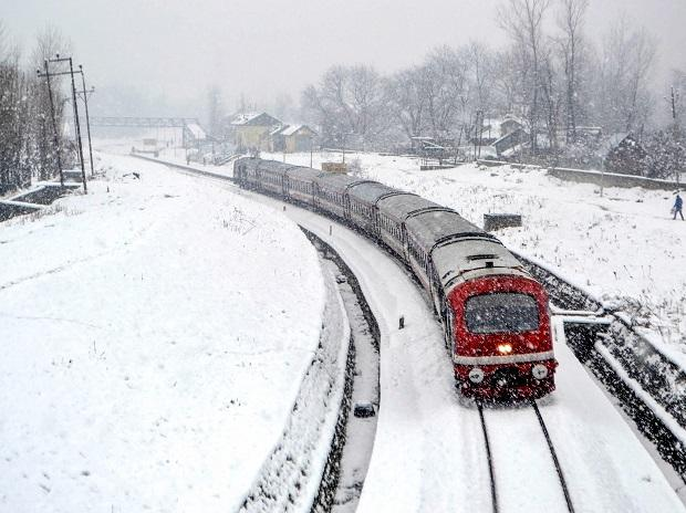 A train trails on a snow-covered Srinagar-Banihal railway track following fresh snowfall, in Anantnag | Photo: PTI