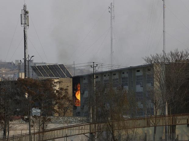 Flames rise from a government building after an explosion and attack by gunmen, in Kabul | AP/PTI
