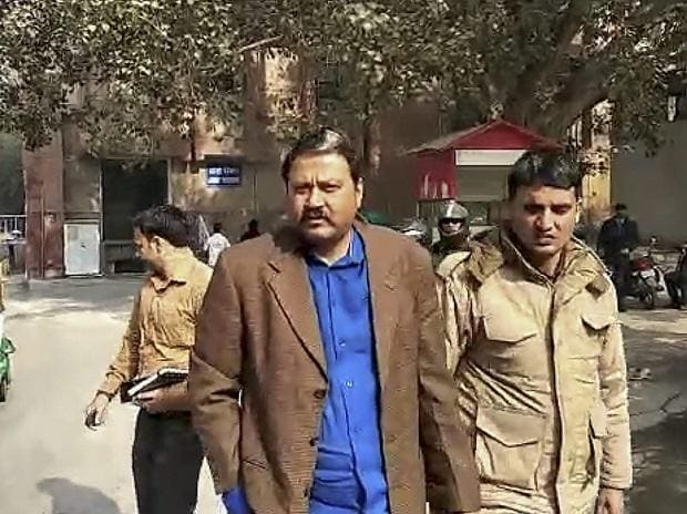 Police arrest former JDU MLA Raju Singh after he was arrested in New Delhi, Thursday, Jan 3, 2019, in connection with the celebratory firing during a New Year's Eve party at his farmhouse. A woman who was wounded in the firing succumbed to her injuri