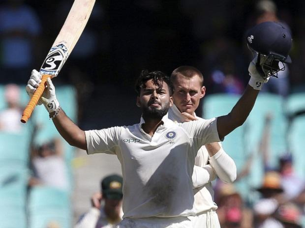 India's Rishabh Pant, left, celebrates making 100 runs as Australia's Marnus Labuschagne watches on day 2 during their cricket test match in Sydney. Photo: AP/PTI
