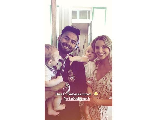 Good Sport Rishabh Pant Turns Baby Sitter For Tim Paine S Young Children Business Standard News