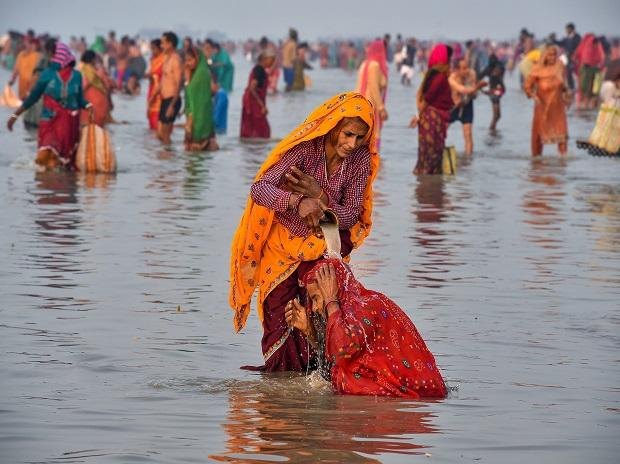 Pilgrims take a holy bath during Ganga Sagar mela