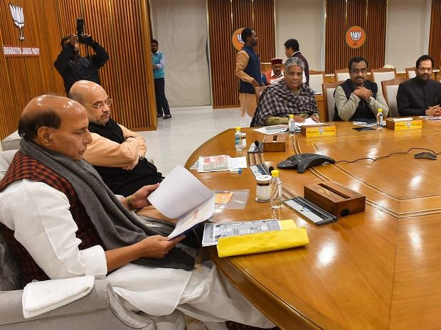 BJP President Amit Shah with Home Minister Rajnath Singh and others during  meeting of party's Lok Sabha Election Manifesto Committee, in New Delhi, Sunday
