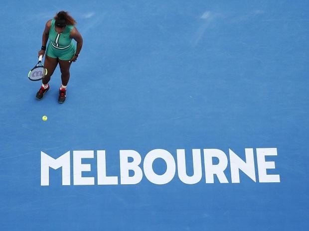 Serena Williams of the U.S. in action against Romania's Simona Halep