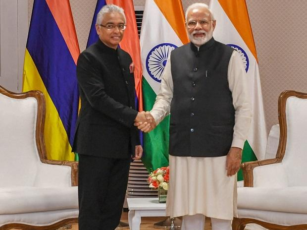 Prime Minister Narendra Modi shakes hands with Mauritius Prime Minister Pravind Jugnauth in a bilateral meeting, in Varanasi, Tuesday, Jan. 22, 2019