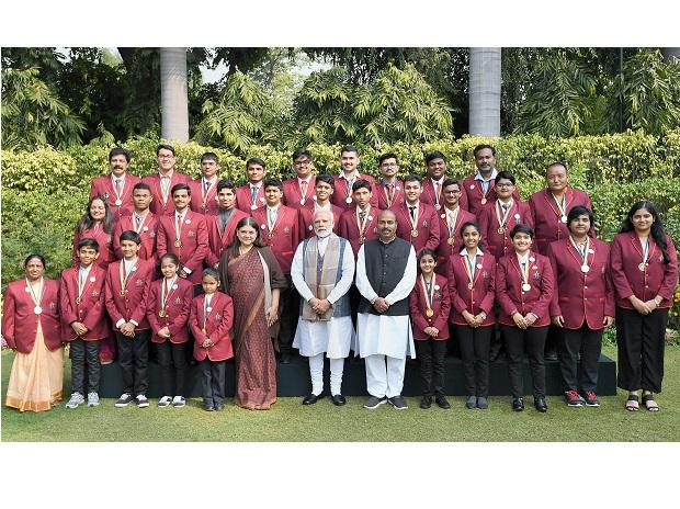 PM Modi and Union Women and Child Development Minister Maneka Gandhi in group photograph with the winners