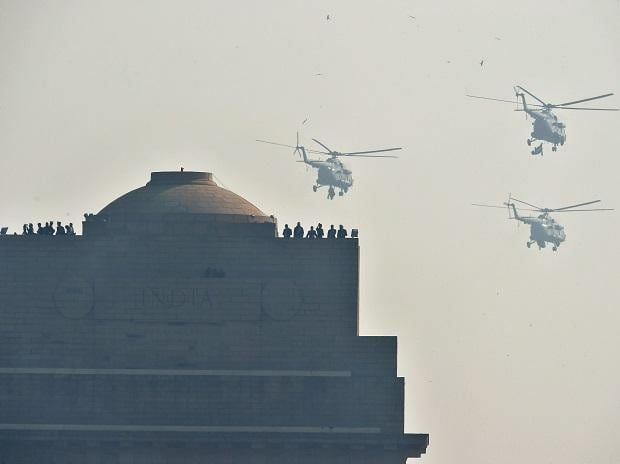 Three ALH Mk IV helicopter fly past the India Gate in 'Rudra' formation