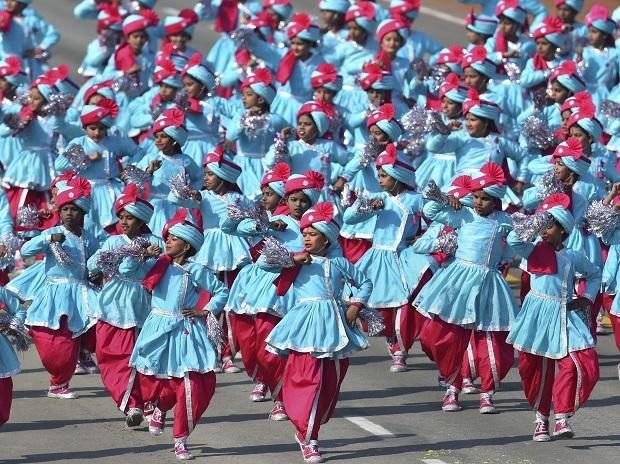 School children perform during the 70th Republic Day Parade at Rajpath