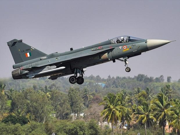 A Tejas aircraft takes off during the inauguration of the 12th edition of AERO India 2019 air show at Yelahanka airbase in Bengaluru, Wednesday