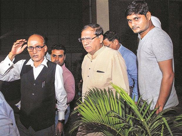 Amrapali group CMD Anil Sharma (centre) outside the company's  corporate office in Noida