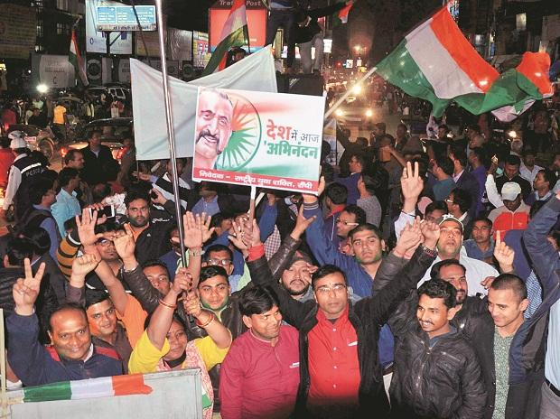 BJP workers jubilate the release of IAF pilot Wing Commander Abhinandan Varthaman by Pakistan on Friday 	photo: pti