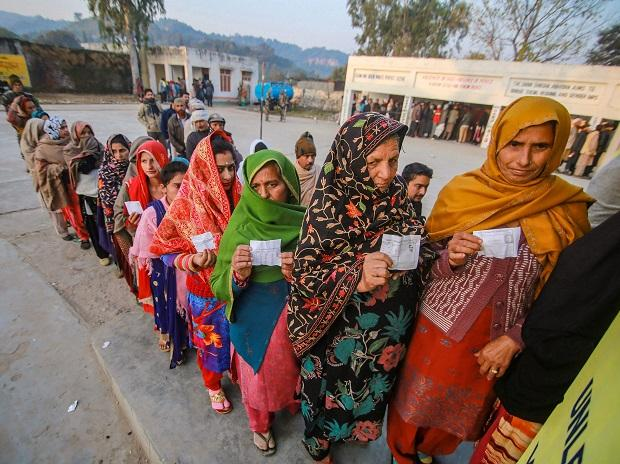 Voters stand in a queue to cast their votes in the 8th phase of panchayat elections at Bajalta village in Jammu. Photo: PTI