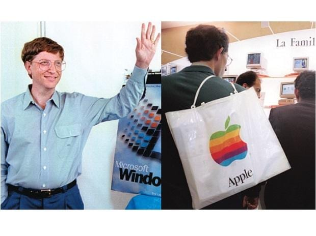 Then Microsoft CEO Bill Gates (left) stands beside a model  of the new Windows 95 product days before its launch. People at the Apple Expo (right) in CNIT centre, Paris, on September 15, 1995. Microsoft and Apple were major players in the personal-co