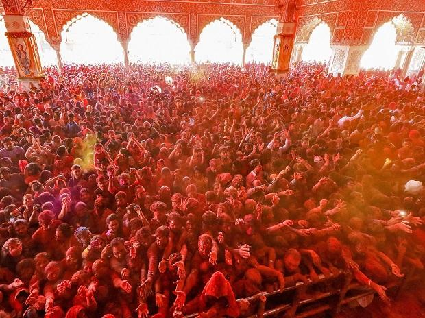 Devotees play with gulal on the occasion of Holi festival celebrations at Govind Dev Ji temple in Jaipur