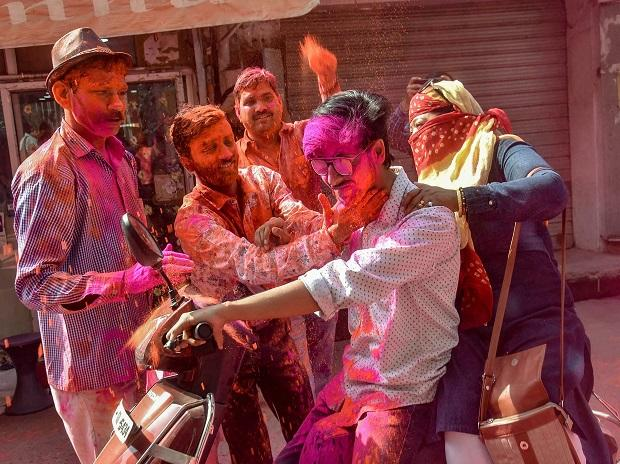 People smear 'Gulal' at each other during Holi celebrations in Lucknow
