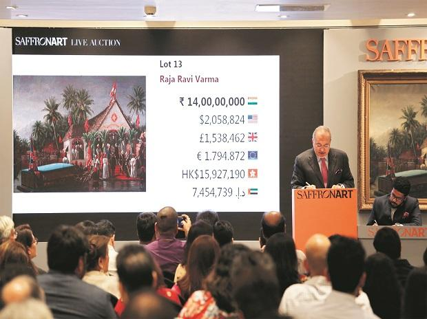Dinesh Vazirani, Saffronart's CEO and co-founder accepting bids at its Spring Live Auction in Mumbai  on Tuesday. Photo: Saffronart