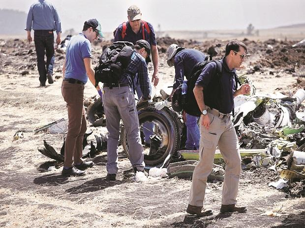 American civil aviation and Boeing investigators search through the debris at the scene of the Ethiopian Airlines Flight ET 302 plane crash near the town of Bishoftu in Ethiopia on March 12 Photo: REUTERS
