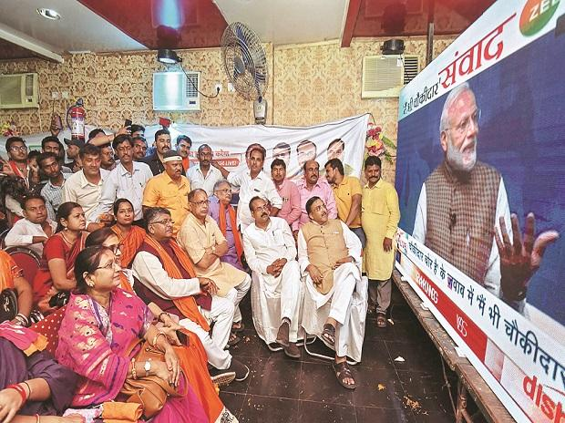 Bharatiya Janata Party workers watch the live telecast of PM Narendra Modi's speech in Patna on Sunday 	Photo:PTI