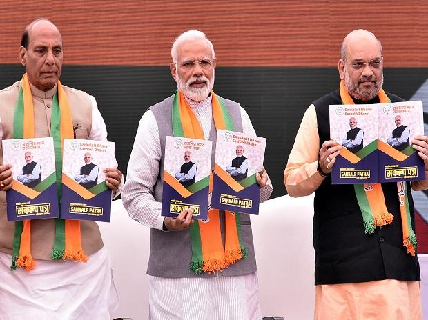 Prime Minister Narendra Modi with BJP President Amit Shah and Union Home Minister Rajnath Singh releasing the Bharatiya Janata Party's (BJP) Manifesto for Lok Sabha Elections 2019, in New Delhi (PHOTO-DALIP KUMAR)