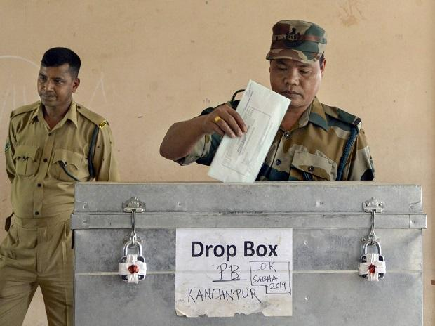 A Tripura State Rifles jawan casts his vote through postal ballot for the Lok Sabha elections in Dharmanagar