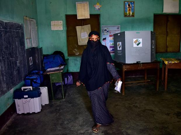 A veiled woman leaves after casting her vote at a polling station during the first phase of general election in Nagaon district