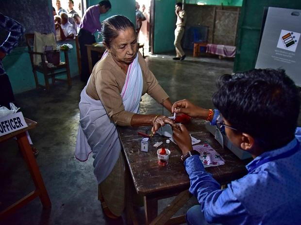 A woman gets her finger inked before casting her vote at a polling station in Nagaon distric