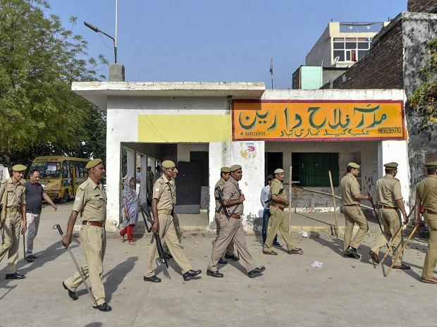 Security personnel seen at a polling station during the first phase of general elections in Ghaziabad