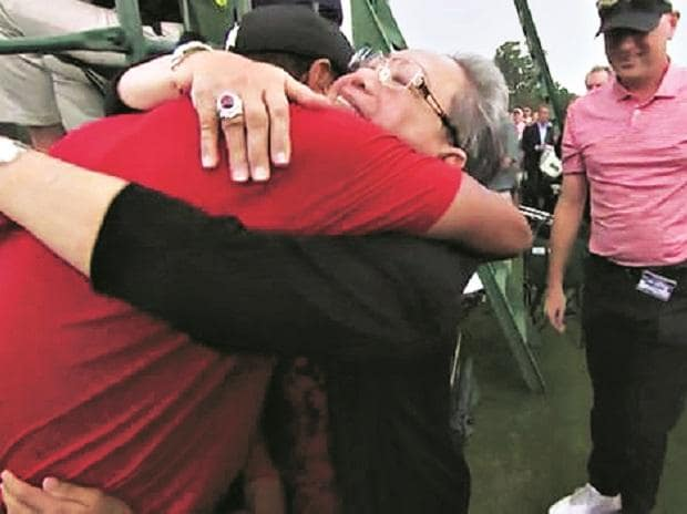 Tiger Woods embraces his mother, Kultida Woods after his Masters victory on April 14