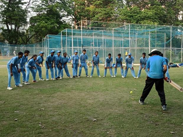 The team at a practice session ; (left) former Indian cricket team captain Sourav Ganguly extends his support for the teams playing at the Street Child Cricket World Cup