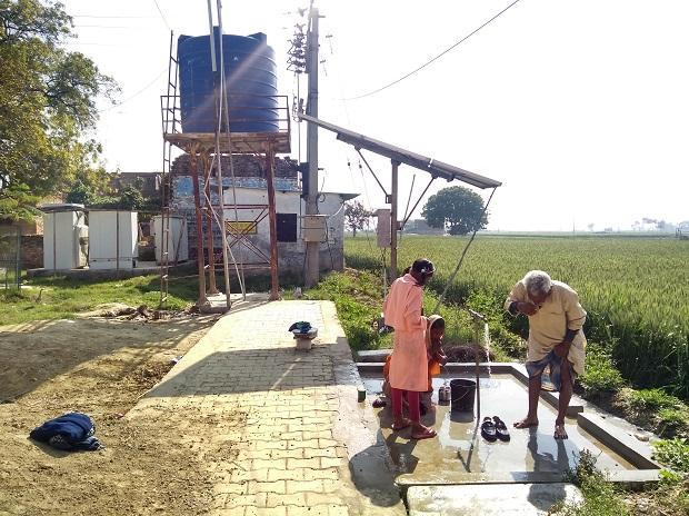 A solar-run water pump at the entry of Jayapur for public use