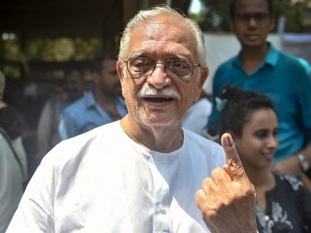 Lyricist and film director Gulzar shows his ink-marked finger after casting vote