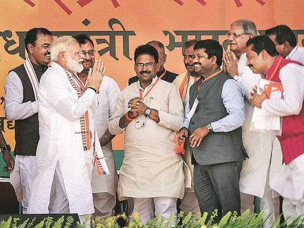 PM Narendra Modi greets BJP leaders as he arrives to address an election rally for the Lok Sabha polls, at Bharwari in Kaushambi district on Wednesday Photo: PTI